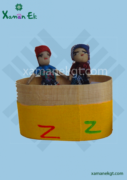 guatemalan worry dolls in a wooden box