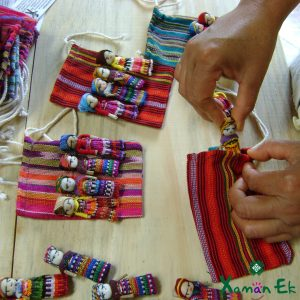 4 worry dolls in a pouch by Xaman Ek