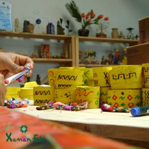 worry dolls in yellow boxes by xaman ek